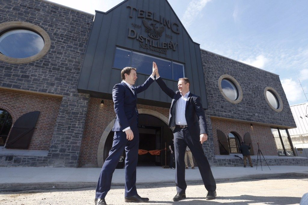 *** NO REPRODUCTION FEE *** DUBLIN : 9/06/2015 : Pictured are brothers Stephen and Jack Teeling at the official opening of the new Teeling Whiskey Distillery and visitor centre in The Liberties, Dublin 8. The €10 million distillery is the first new distillery in Dublin in over 125 years and the only fully operational distillery in the city. As well the distillery, there is a state-of-the-art visitor centre, which will host whiskey tasting tours, a café, a bar, a private event space for hire and a gift shop. Founded by Jack Teeling in 2012, the Teeling Whiskey Company (TWC) was set up to revive his family-old trademark of Irish whiskey and bring distilling back to Dublin. TWC is run by Jack together with his brother Stephen and the opening of this new distillery means that they have complete control of all aspects of their whiskey production, from grain to bottle. The distillery will be open to the public from Saturday, June 13th, 9.30am - 5.30pm. For more, visit www.TeelingWhiskey.com Picture Conor McCabe Photography. MEDIA CONTACT : Sarah Doyle, notorious PSG E: sarah.doyle@notoriouspsg.ie M:+353 879530551